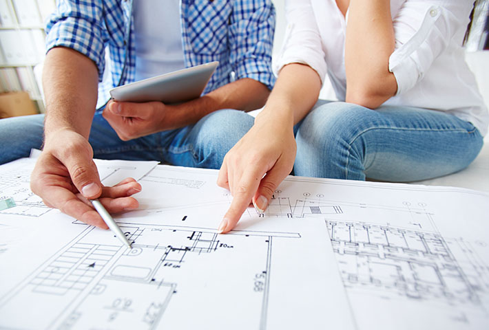 couple studying house floor plan