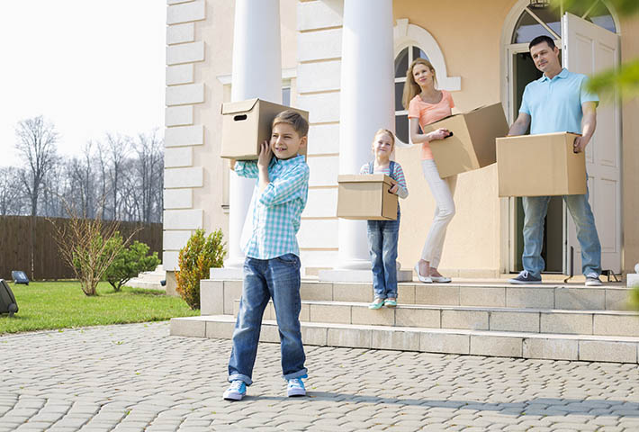 family of four preparing for moving