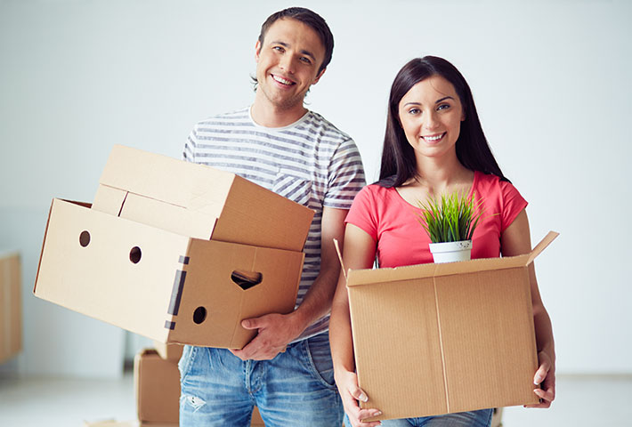 happy couple preparing for house move