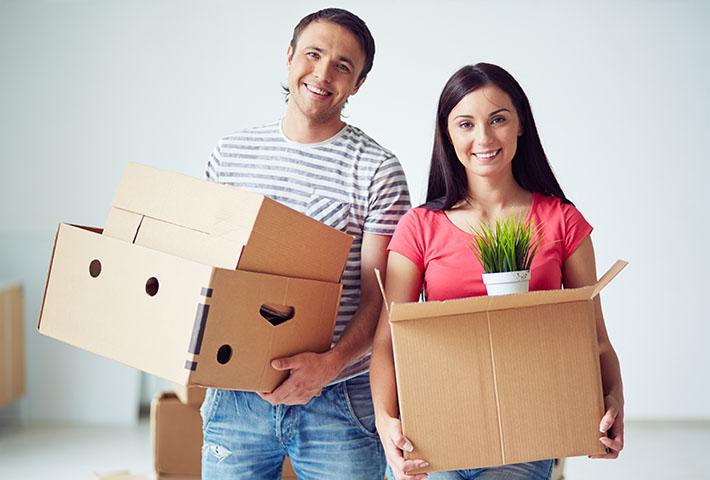 happy couple preparing for house move
