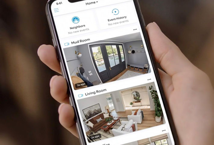 man checking home with security app