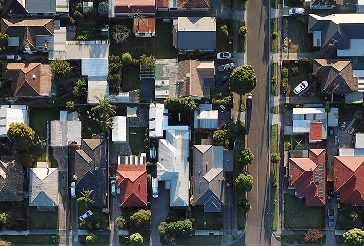neighborhood houses roofs aerial view