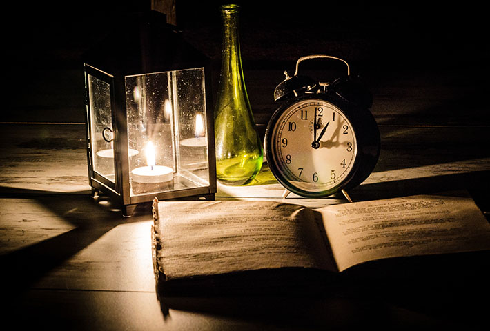 open book clock and candle