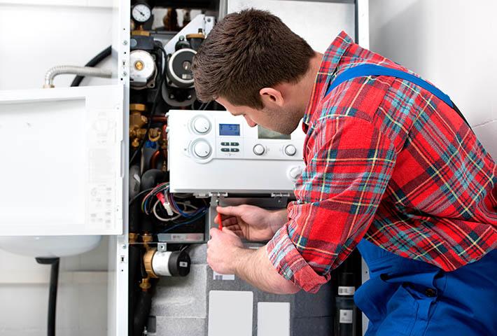 specialist repairing boiler