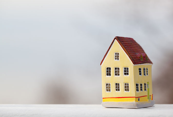 yellow house miniature figurine