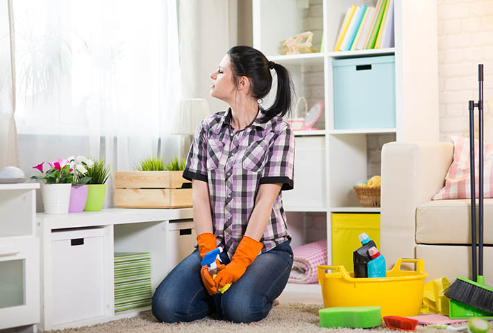 young woman resting after home cleaning