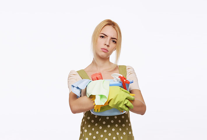 young woman with cleaning products